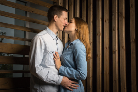 Beautiful couple in a room lined with wood Stock Photo