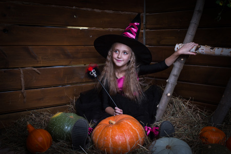 naughty or nice: Cute little girl witch in black dress