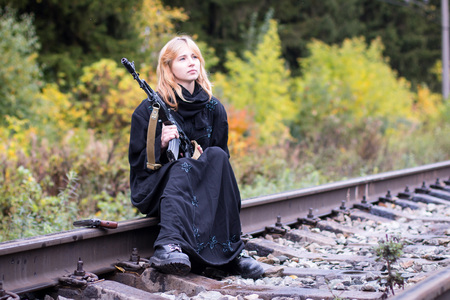 saboteur: Woman in muslim dress with arms on the rails