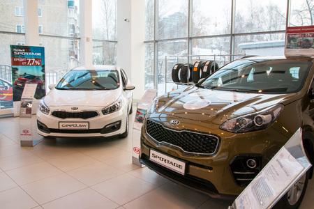 kirov: Russia, Kirov - December 05, 2016: Showroom and car KIA of dealership KIA-Zentr Kirov in Kirov city in 2016