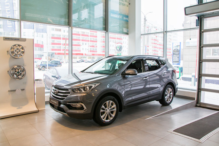 kirov: Russia, Kirov - December 06, 2016: Showroom and car of dealership Hyndai in Kirov city in 2016 Editorial