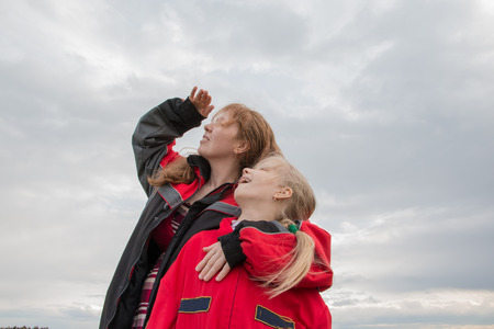 activ: Mother and daughter outdoor and cloudy sky background