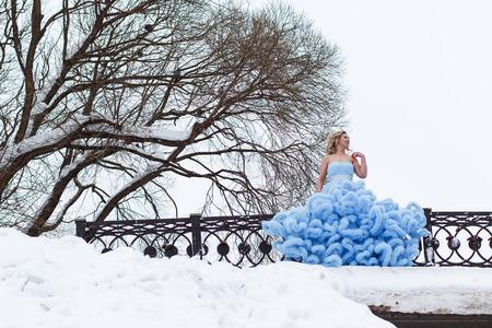 blue dress: Woman in a beautiful blue dress in a winter day