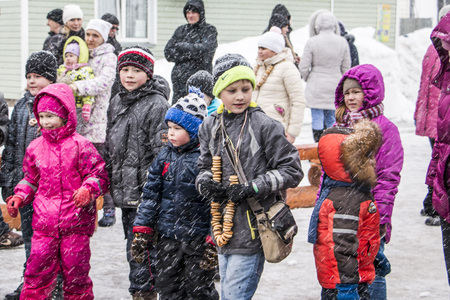 maslenitsa: Kirov, Russia - March 13, 2016: People during the celebration of the end of winter named Maslenitsa in village Shichovo near Kirov city in 2016 Editorial