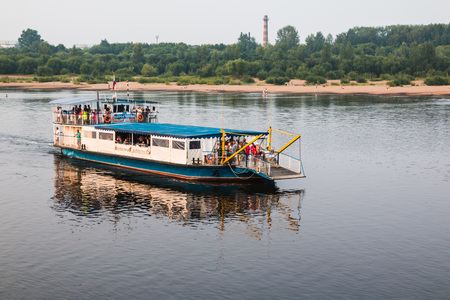 Russia, Kirov - June, 22, 2016: Boat on the river and the people in a summer evening in Kirov city in 2016