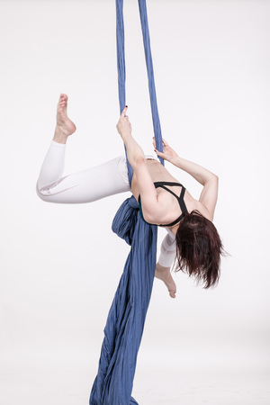 sexy girl dance: Nice girl and sports exercises with aerial silk Stock Photo
