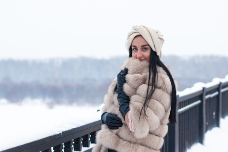 Nice girl outdoor in a winter day