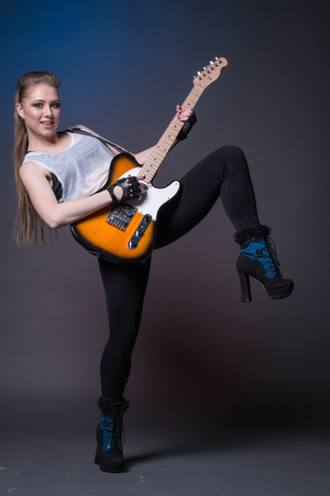 The girl with the guitar during a performance Stock Photo