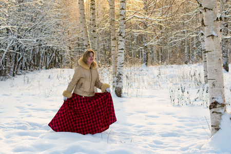 snowdrifts: Woman in the forest in a sunny winter day