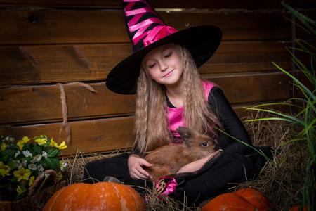 warlock: Cute little girl witch in black dress