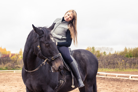 Girl and horse in an autumn day Stock Photo