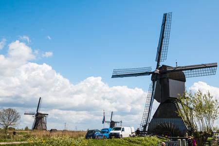 """watermill: Netherlands, Kinderdijk -€"""" April, 26, 2017: Mills and water channel in Kinderdijk in 2017"""