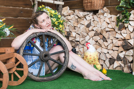 Ugly woman in traditional dress posing in a rustic interior Stock Photo