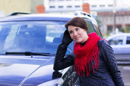 Nice girl in red scarf outdoor in autumn day Stock Photo