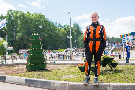 Russia, Kirov - June, 12, 2017: Presenter representing open for citizens of city automobile competition in the birthday of the city Kirov in 2017