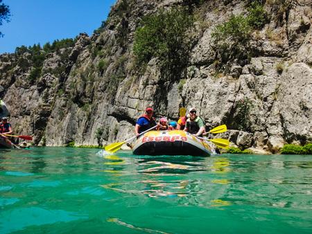Side, Turkey - June, 25, 2017: People in boat during rafting in Side in 2017