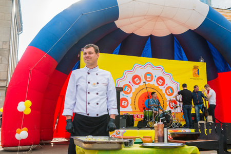 Russia, Kirov - June, 12, 2017: People in the open festival called Delicious Vyatka - Vkusnaya Vyatka during barbecue in the birthday of Kirov city in 2017 Editorial