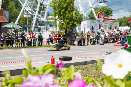 Russia, Kirov - June, 12, 2017: Car and kart driver in fast moving during the open competitions in the birthday of city Kirov