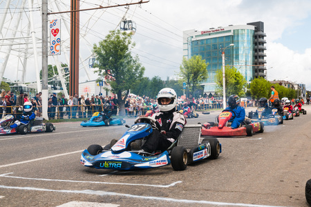 Russia, Kirov - June, 12, 2017: Car and kart driver during the open competitions in the birthday of city Kirov