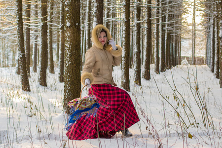 Woman in the forest in a sunny winter day