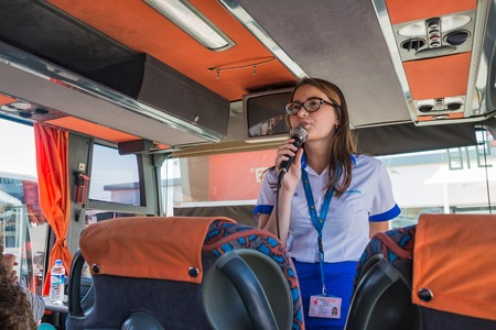 Side, Turkey - June, 22, 2017: Guide in a tourist bus in Turkey in Side