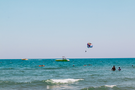 Side, Turkey - June, 26, 2017: Fly with colorful parachute at the beach