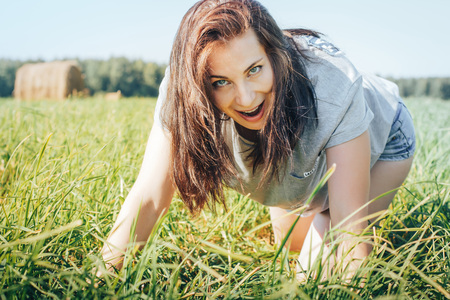 Girl in an autumn field with hay stack Stock Photo