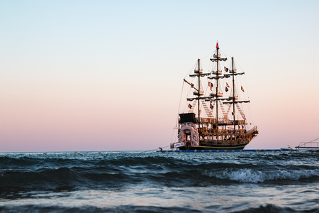 Pirate ship on the sea in a summer evening Publikacyjne