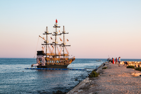 Pirate ship on the sea in a summer evening Editorial