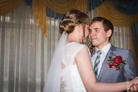 Young bride and groom together in the room