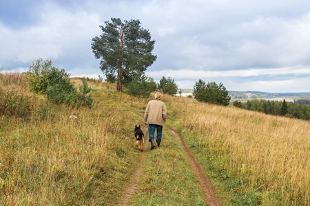Big man with big dog german shepherd in the countryside in nature Stok Fotoğraf