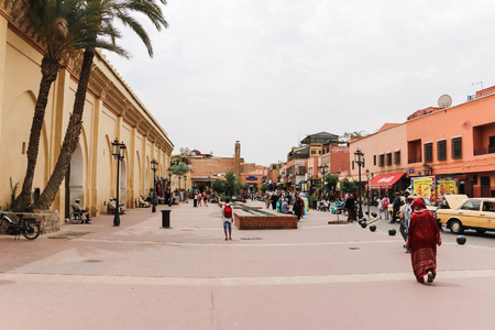 Marrakech, Morocco - May 17, 2016 : People walking on the street in Marrakech in Morocco