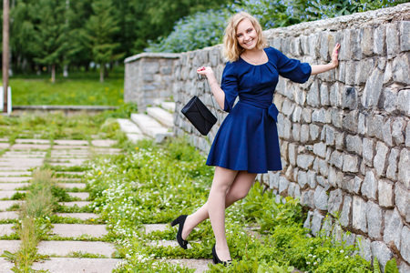 Young attractive blond woman in a summer green park  Reklamní fotografie