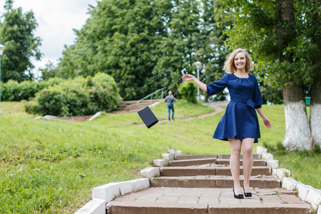 Young attractive blond woman in a summer green park  Reklamní fotografie