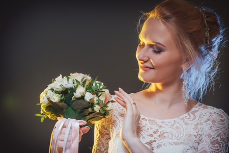 Beautiful bride in a white dress in the Studio during a photoshoot with nice light Stock Photo