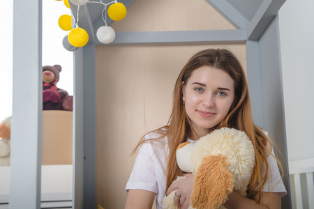 Young woman in children room with toy. Life stile