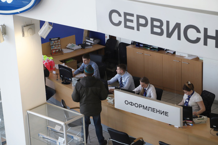 Kirov, Russia - March 14, 2018: Managers in showroom of dealership Ford in Nizhny Novgorodcity in 2018