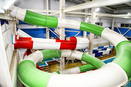 Multi-colored slides in the indoor water Park
