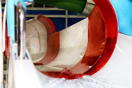 Multi-colored slide in the indoor water Park Stock Photo