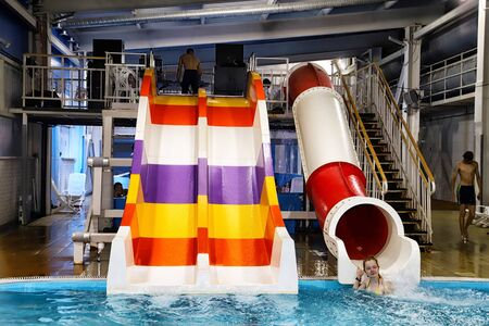 Kirov, Russia - August 19, 2018: Teenagers and slides on party AQUA MADFLOW at Russia in Kirov city in AquPark named Friendship Standard-Bild - 143148185