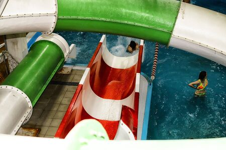 Kirov, Russia - August 19, 2018: Teenagers and slides on party AQUA MADFLOW at Russia in Kirov city in AquPark named Friendship Standard-Bild - 143148188