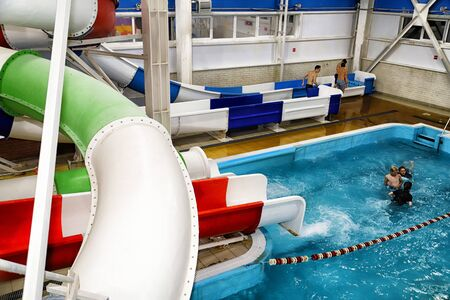 Kirov, Russia - August 19, 2018: Teenagers and slides on party AQUA MADFLOW at Russia in Kirov city in AquPark named Friendship Standard-Bild - 143148189