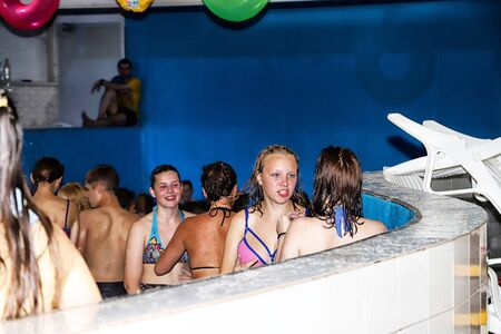 Kirov, Russia - August 19, 2018: Teenagers in Jacuzzi during party AQUA MADFLOW at Russia in Kirov city in AquPark named Friendship Standard-Bild - 143148331