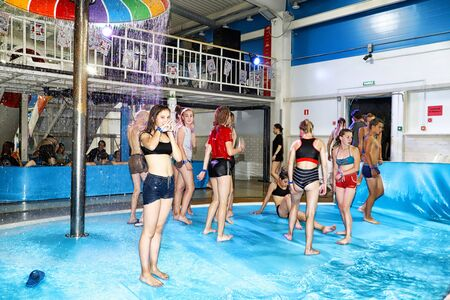 Kirov, Russia - August 19, 2018: Teenagers on party AQUA MADFLOW at Russia in Kirov city in AquPark named Friendship Standard-Bild - 143148339