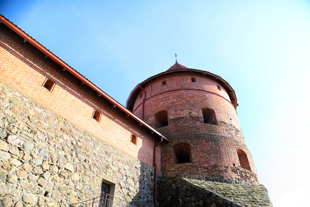 Island castle in Trakai. One of the most popular touristic destinations in Lithuania in a sunny day during early spring