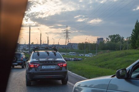 Kazan, Russia - May 18, 2018: Cars on the track in the summer day near Kazan in Tatarstan in Russia. Shooting from a car Editorial