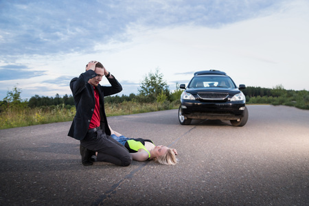 Man hitting female pedestrian on the road in the summer evening. Photoshoot