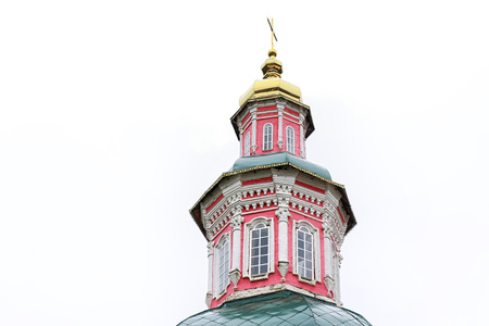 The bell tower of the Church with domes with cross in a day