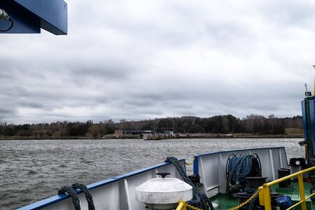 Klaipeda, Lithuania - April 02, 2018: View of the pier from the ferry in Klaipeda. Cloudy day
