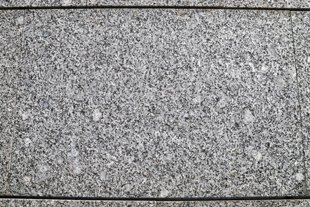 Texture of the wall for background. Roughness and irregularity. Grey marble crumb